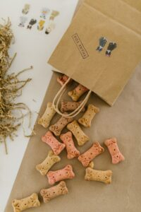 Dog treats out of paper bag.