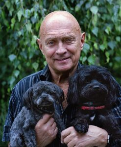 Elder man with two dogs.