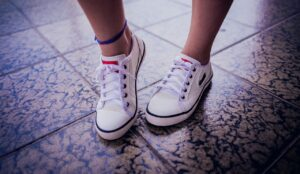 Feet on floor.