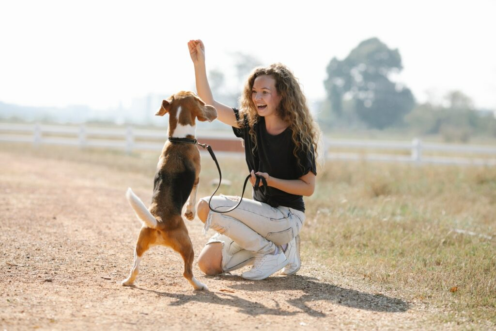 Woman playing with dog.
