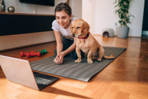 Girl and dog online training.