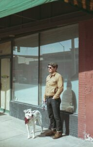 Man and dog standing.