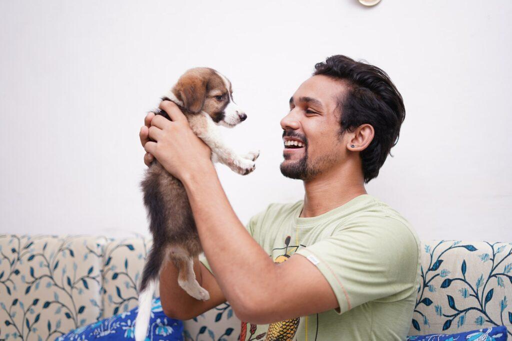 Man holding a puppy.